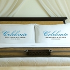 Pair of pillowcases, each pillowcase includes the words Celebrate and the first names of a couple and date.