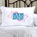 Pillowcase with monogram in the center, letters from left to right are SMR, the M is slightly larger than the S and R.