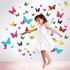 Girl jumping and in the background a wall decal of a great many colorful butterflies are flying.
