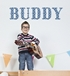 Boy playing a guitar below the word BUDDY in blue luv letters.