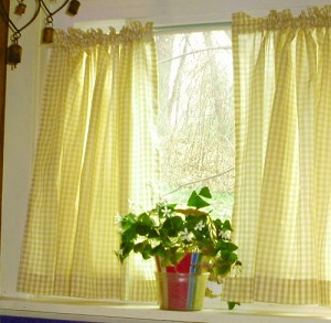 Stock Image: Gingham Yellow Kitchen Curtain